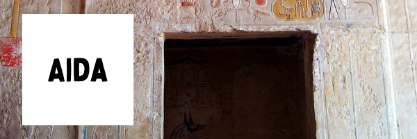 """header that says """"Aida"""" plus the door to a tomb in Egypt"""